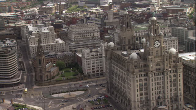 the royal liver building, cunard building, and port of liverpool building at pier head line the waterfront of the mersey river. - liverpool england stock videos & royalty-free footage