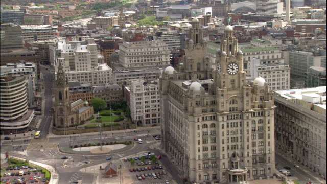the royal liver building, cunard building and port of liverpool building stand on the pier head waterfront in liverpool, england. - merseyside stock videos & royalty-free footage