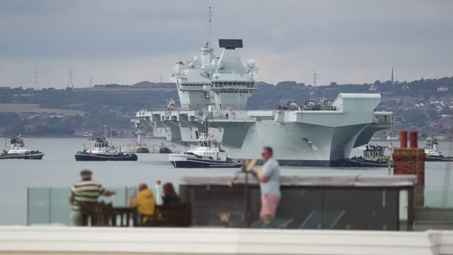 "the royal navy aircraft carrier hms queen elizabeth has set sail from portsmouth following two subsequent days of delays caused by ""fewer than 10""... - group of people stock videos & royalty-free footage"