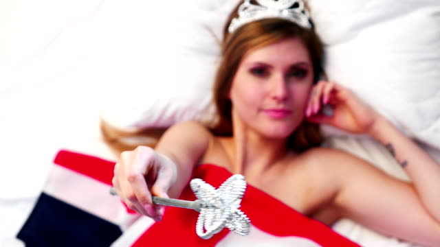 the royal scepter in the hands of a beautiful model on the british flag - queen royal person stock videos & royalty-free footage