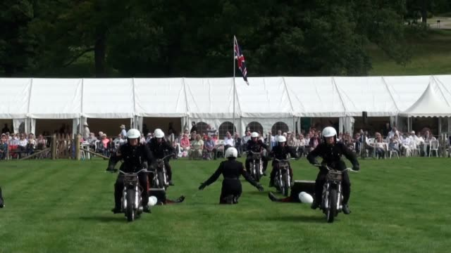 the royal signals motorcycle display team, also known as the white helmets, perform during the opening day of the chatsworth country fair at... - stunt stock videos & royalty-free footage