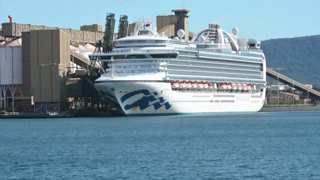 the ruby princess cruise ship sits docked at port kembla south of sydney where it is expected to remain for several days after hundreds of crew... - cruise ship stock videos & royalty-free footage