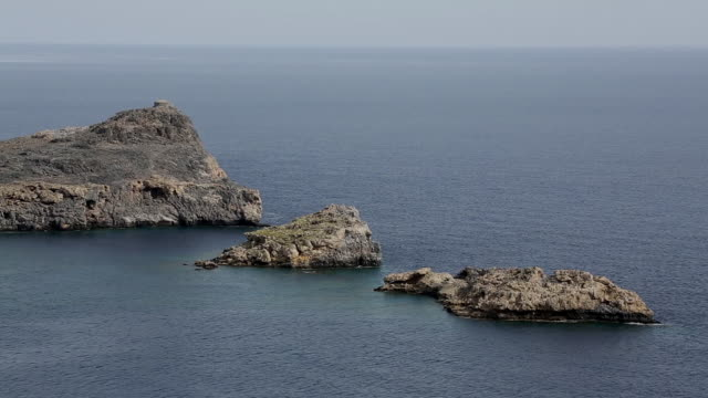 the rugged coastline near lindos - rhodes dodecanese islands stock videos & royalty-free footage