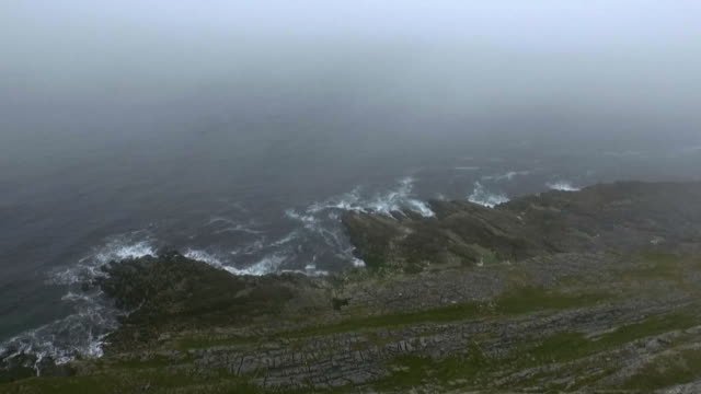 the rugged coastline of the 'wild atlantic way', a coastal route along the west of ireland. - fog stock videos & royalty-free footage