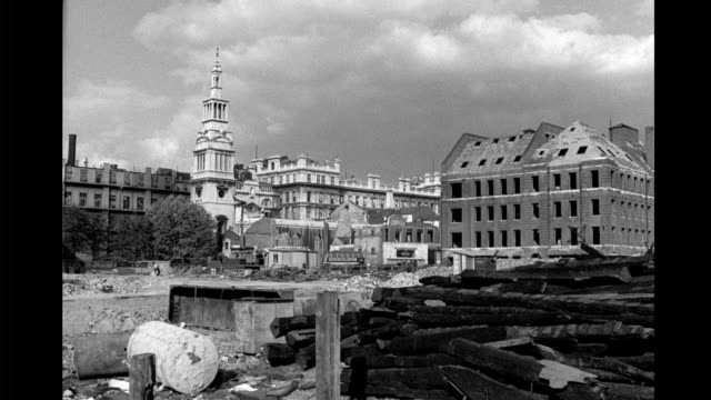 the ruined christ church greyfriars, surrounded by bomb damaged buildings. bombed out christ church greyfriars on september 09, 1943 in london - damaged stock videos & royalty-free footage