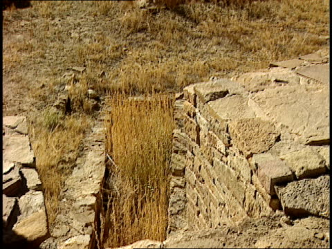 the ruinous walls of the casa rinconada still stand in chaco canyon, new mexico. - chaco canyon stock videos & royalty-free footage