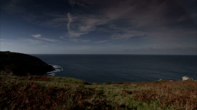 the ruins of a tin mine overlooks the ocean, cornwall. available in hd. - tin mine stock videos & royalty-free footage
