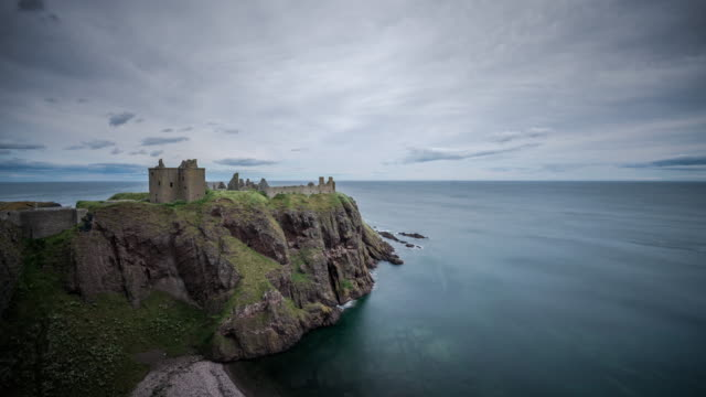 The ruins of Dunottar Castle a mediaeval fortress rest on top a rocky headland with dramatic cliffs overlooking Old Hall Bay