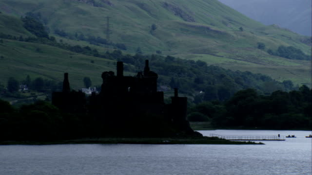 The ruins of Kilchurn Castle loom over Loch Awe. Available in HD.