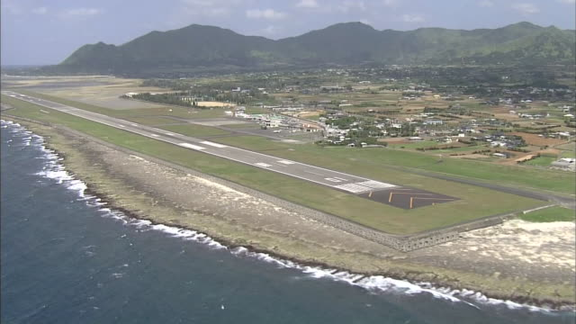 The runway of Tokunoshima Airport stretches along the coast of  Tokunoshima Island, Japan.