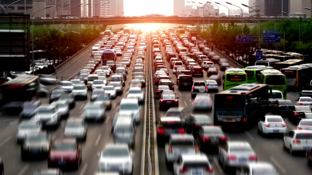 the rush hour commute in a city - pollution stock videos & royalty-free footage