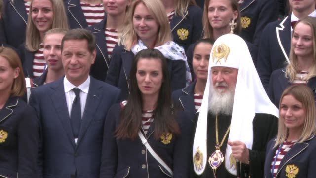 vídeos de stock, filmes e b-roll de the russian olympic team attends a religious ceremony to be blessed by the influential head of the russian orthodox church patriarch kirill before... - rio russian