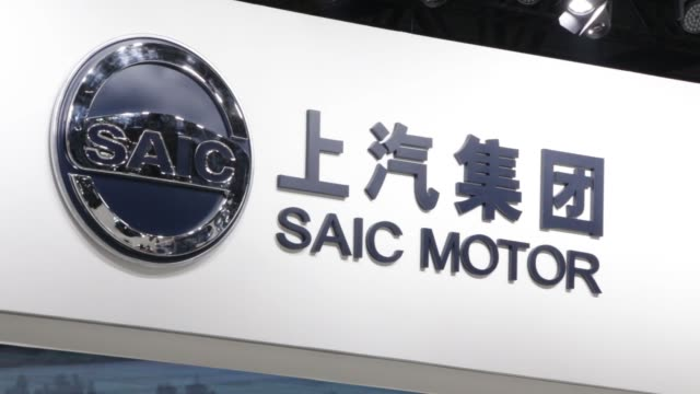 MS The SAIC Motor Corp logo is displayed above the company's booth WS The SAIC Motor Corp MG3 vehicle on display CS badge and logo on radiator grille...