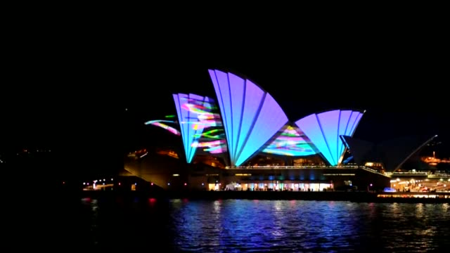 the sails of the sydney opera house are lit with a 3d-like effect on friday during the launch of vivid sydney, reportedly the southern hemisphere's... - southern hemisphere stock videos & royalty-free footage