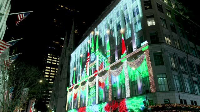"the saks 5th avenue iconic christmas window display and ten-story-tall theatrical light show titled, ""saks lights up fifth avenue"" on december 08,... - around the fair n.y stock videos & royalty-free footage"