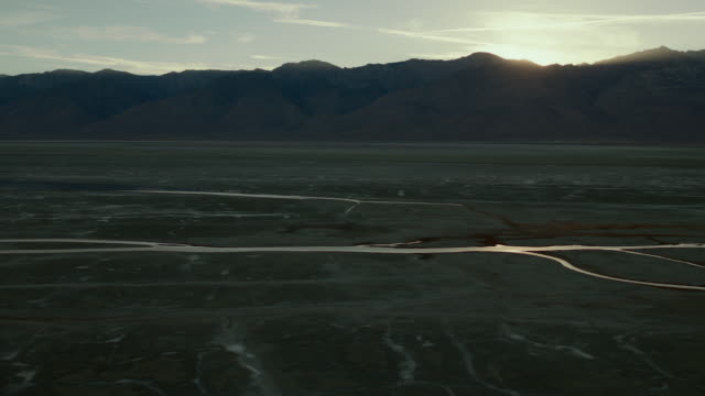 the salt flats and sparse rivulets of water of owens lake, inyo county, california. - basin and range province stock videos and b-roll footage