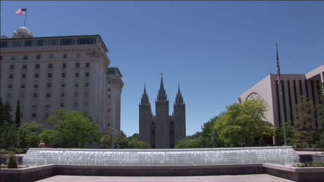 The Salt Lake Temple overlooks a fountain on Temple Square.