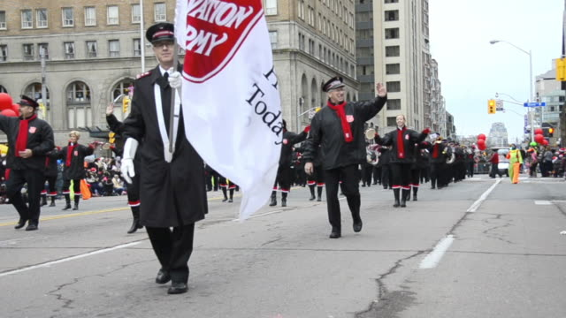 the salvation army block marching in the corner of bloor street and queens park. the event is a tradition held in the canadian city for more than a... - salvation army stock videos & royalty-free footage