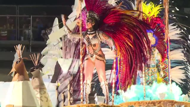 the sambodrome in rio de janeiro pulsates with excitement as the main samba schools in the city dazzle the crowds with their costumes and dance moves - brazilian carnival stock videos and b-roll footage