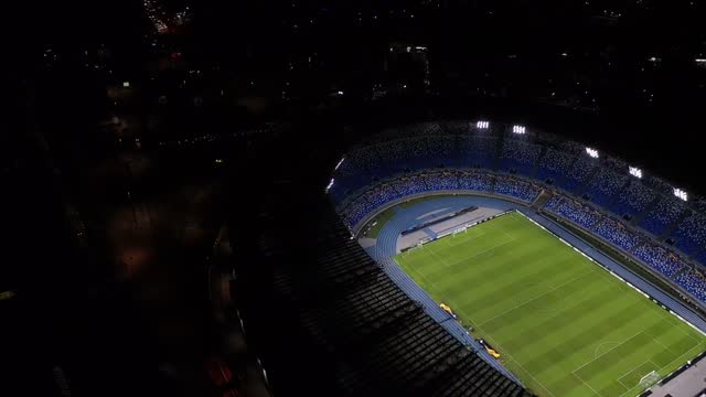 the san paolo stadium is lit as a tribute to the late soccer player diego armando maradona on november 25, 2020 in naples, italy. diego armando... - ナポリ点の映像素材/bロール