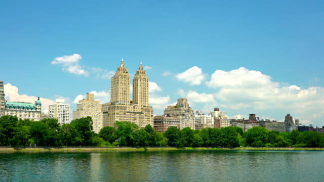 the san remo, apartment building behind the pond, central park - remo stock videos and b-roll footage