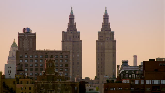the san remo towers stand tall against a clear morning sky along central park west. - upper west side manhattan stock videos and b-roll footage