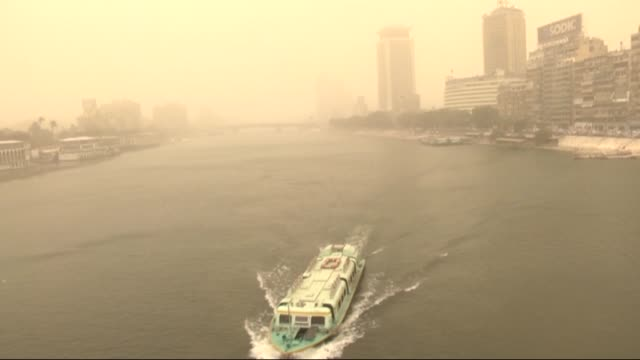 the sandstorm hits egypt and many people are affected badly in traffic due to sandstorm in cairo egypt on 10 february 2015 - sandstorm stock videos & royalty-free footage
