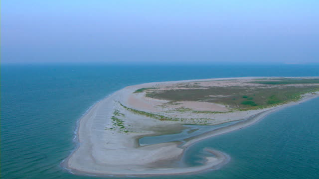 The sandy shores of Round Island, Mississippi reach out into the aquamarine waters of the Gulf of Mexico.