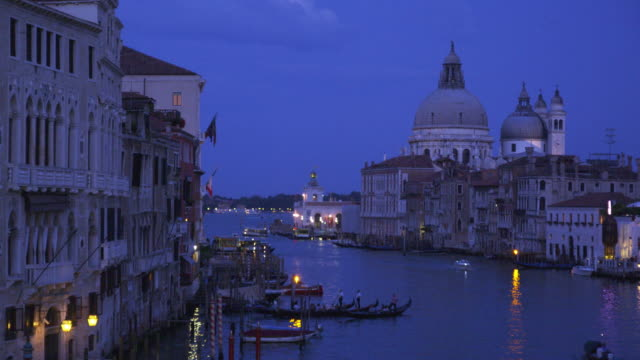 the santa maria della salute overlooks the grand canal at golden hour. - golden hour stock videos & royalty-free footage