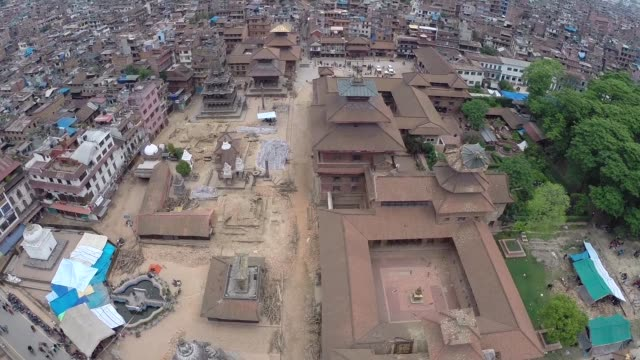 the scale of devastation caused by the 7.5 magnitude earthquake that hit nepal on saturday, can be seen in this aerial footage, as hundreds of homes... - kathmandu stock videos & royalty-free footage