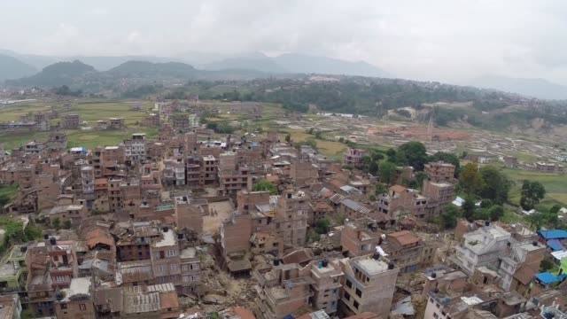 the scale of devastation caused by the 7.5 magnitude earthquake that hit nepal on saturday, can be seen in this aerial footage, as hundreds of homes... - nepal stock videos & royalty-free footage