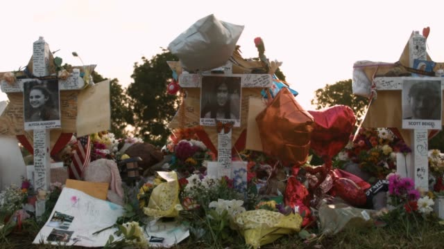 the scene in front of marjory stoneman douglas high school is seen after on february 21 2018 in parkland florida police arrested and charged 19 year... - mourning stock videos & royalty-free footage