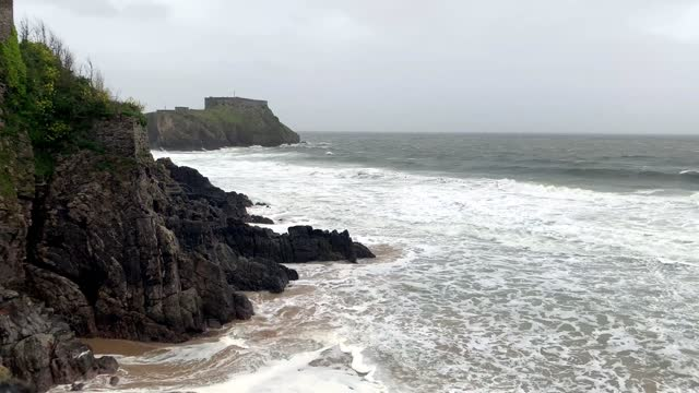 the scene of waves rolling onto south beach in high winds on may 20 in tenby, wales. the met office has issued a yellow beware warning with winds... - rolling stock videos & royalty-free footage