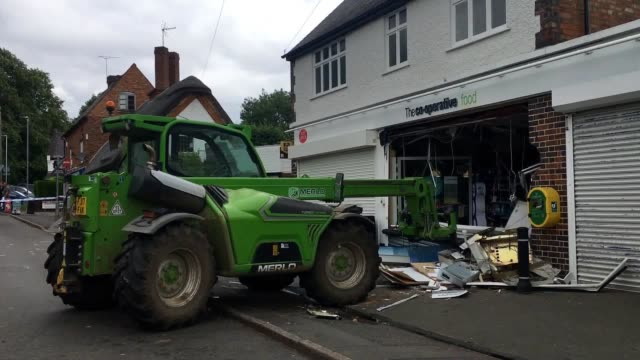 the scene on main street in scraptoft leicester where a stolen forklift truck was used to ram a cooperative food store in an attempt to steal a cash... - stealing stock videos & royalty-free footage