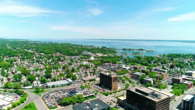 the scenic aerial remote view of the new rochelle marina over the residential district - new york stato video stock e b–roll