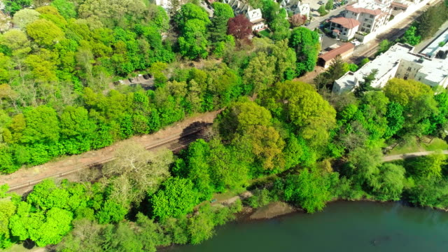 The scenic aerial view of Bronxville village over the Bronx River Park and the Bronx River.