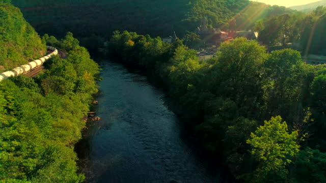 the scenic aerial view of the lehigh river near by jim thorpe, pennsylvania, at sunset. - sunbeam stock videos & royalty-free footage