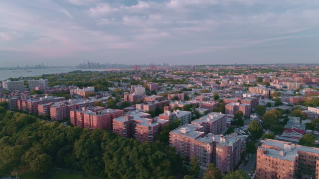 the scenic aerial view toward manhattan over brooklyn, hudson river and belt parkway, new york, usa - staten island stock videos and b-roll footage