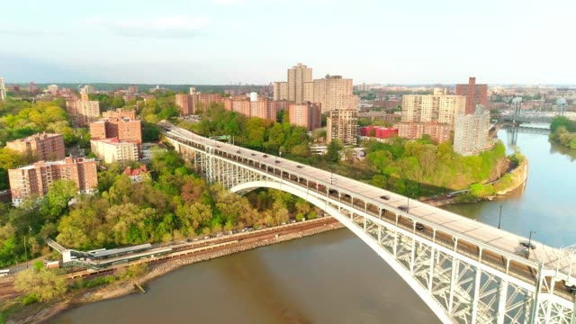 the scenic panoramic aerial view to bronx over the henry hudson bridge, along the hudson river. the passenger train departing from the train station. - elevator point of view stock videos and b-roll footage
