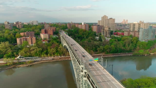 the scenic panoramic aerial view to bronx over the henry hudson bridge - bronx new york stock videos and b-roll footage