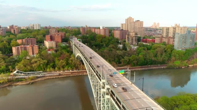 the scenic panoramic aerial view to bronx over the henry hudson bridge, with the passenger train passing the trainstation. the speeded-up video - elevator point of view stock videos and b-roll footage