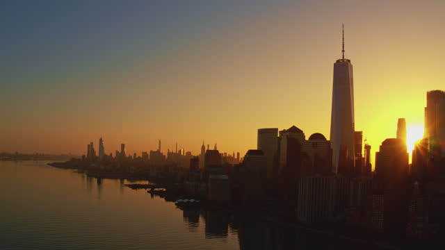 the scenic view of manhattan across the hudson river, from jersey city, at the sunrise. aerial footage with the cinematic panoramic camera motion. - world trade center manhattan stock videos & royalty-free footage
