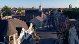 The scenic view of the small historic Pennsylvanian town Bath at sunset. Appalachian mountains, Pennsylvania, USA. Aerial drone video with the forward and ascending camera motion along the street.