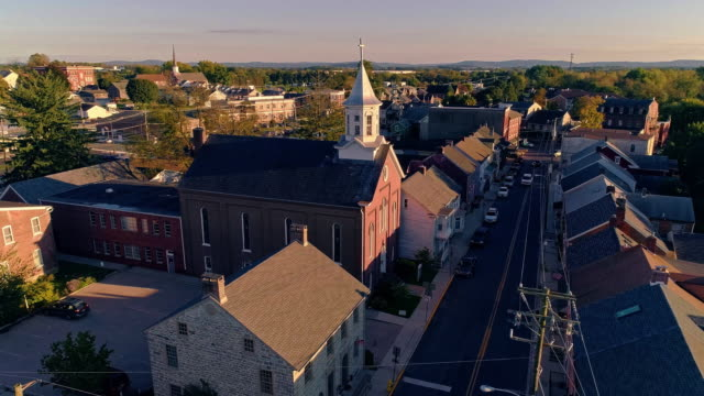 the scenic view of the small pennsylvanian town bath at sunset. appalachian mountains, pennsylvania, usa. aerial drone video with the panoramic camera motion. - small town america stock videos & royalty-free footage
