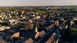The scenic view of the small Pennsylvanian town Bath at sunset. Appalachian mountains, Pennsylvania, USA. Aerial drone video with the backward camera motion.