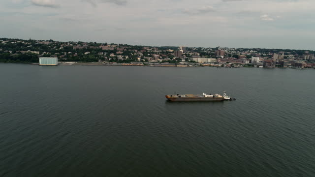 The scenic view to Yonkers, New York State over the Hudson River from New Jersey. Aerial drone video.