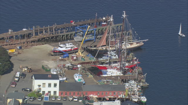 aerial the schooner thomas e. lannon berthed at the historic seven seas wharf / gloucester, massachusetts, united states - gloucester massachusetts stock videos & royalty-free footage