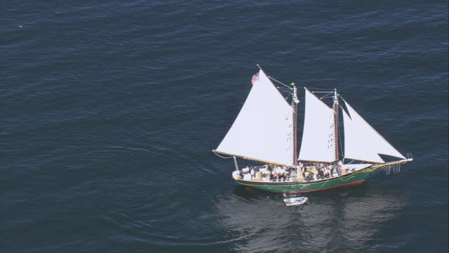 aerial the schooner thomas e. lannon sailing through the water / gloucester, massachusetts, united states - gloucester massachusetts stock videos & royalty-free footage