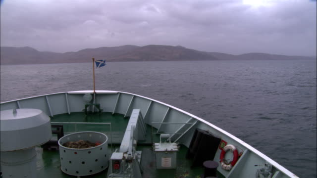 the scottish flag flies at the bow of a ship. - scottish flag stock videos & royalty-free footage