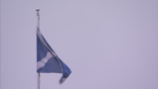 the scottish flag flutters in the wind. - scottish flag stock videos & royalty-free footage